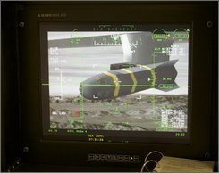 An unmanned aerial vehicle's Predator Hellfire missile is shown on a simulator's virtual camera at the March Air Reserve Base in Riverside County, Calif., June 25, 2008. As the U.S. military scrambles to get more robotic warplanes like the Predator drone aloft, it is confronting an unexpected adversary