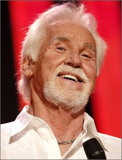 In this June 7, 2008 file photo, country artist Kenny Rogers is shown at the CMA Music Festival  in Nashville, Tenn.  (AP Photo/Bill Waugh, file)