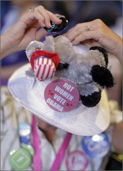 Linda Spisak, of Hobe Sound, Fla., adds pins to her hat before the second session of the Democratic National Convention gets started in Denver, Tuesday, Aug. 26, 2008. (AP Photo/Jae C. Hong)