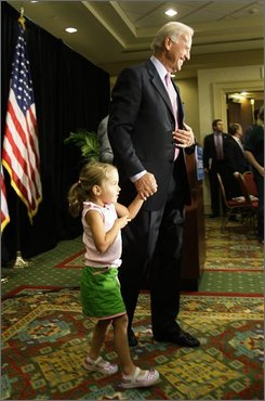 Democratic vice-presidential candidate Sen. Joe Biden, D-Del. holds the hand of his granddaughter Natalie Biden, 4, as he attends the Delaware Delegation breakfast, Tuesday, Aug. 26, 2008, in Littleton, Colo., on the second day of the Democratic National Convention. (AP Photo/Ted S. Warren)