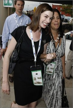 Actress Anne Hathaway, left,  arrives at the Democratic National Convention in Denver, Monday, Aug. 25, 2008. (AP Photo/Matt Sayles)