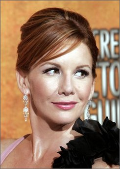 """In this Feb. 5, 2005 file photo, Melissa Gilbert poses backstage at the 11th annual Screen Actors Guild Awards in Los Angeles. Fans will get an extra chance to see the sold-out """"Little House on the Prairie"""" musical at the Guthrie Theater, starring Melissa Gilbert. Because of high ticket demand, the Guthrie has added 12 seats to the second balcony, an area normally reserved for technicians and production staff. (AP Photo/Reed Saxon, file)"""