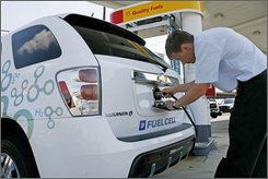Thomas Albert, of Alexandria, Va., tries to fuel his Chevrolet Equinox Electric Fuel Cell Vehicle at a Shell Hydrogen Fueling station in Washington on Wednesday June 25, 2008. (AP Photo/Jacquelyn Martin)