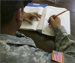  Army private Edurado Arceo, of Pamona, Ca., studies for his General Educational Development certificate in a new Army program dedicated to helping high school dropouts earn their GEDs before they move on to basic training Thursday, Aug. 21, 2008, at Fort Jackson, S.C. (AP Photo/Mary Ann Chastain)