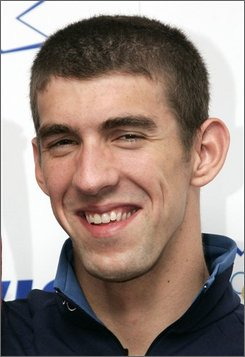 In this Aug. 24, 2008 file photo, U.S. swimmer Michael Phelps, winner of 8 gold medals at the Beijing Olympic, is shown at a press conference in London. (AP Photo/Sang Tan, file)