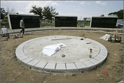 Work continues on the Hurricane Katrina memorial in New Orleans, Thursday, Aug. 21, 2008.  The land was vacant just five weeks ago and workers are rushing to complete the memorial by the third anniversary of the hurricane, which is Friday. (AP Photo/Bill Haber)