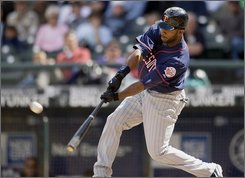Minnesota Twins' Denard Span its a two-RBI double against the Seattle Mariners during the fourth inning of their baseball game in Seattle Wednesday, Aug. 27, 2008. (AP Photo/John Froschauer)