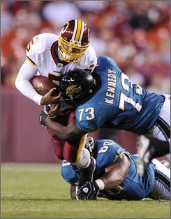 Washington Redskins quarterback Colt Brennan (5) is sacked by Jacksonville Jaguars defensive tackle Jimmy Kennedy (73) during the second quarter of an NFL preseason football game, Thursday, Aug. 28, 2008, in Landover, Md.(AP Photo/Nick Wass)