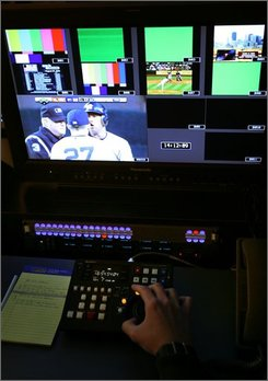 A technician demonstrates some of the new instant replay capabilities at the network operations center at MLB.com in New York, Wednesday, Aug. 27, 2008. Umpires will be allowed to check video on home run calls starting Thursday, Aug. 28, after Major League Baseball, guardian of America's most traditional sport, reversed its decades-long opposition to instant replay.  (AP Photo/Seth Wenig)
