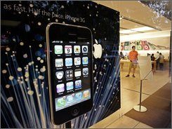 In this July 7, 2008 file photo, the new Apple iPhone 3G is advertised in Palo Alto, Calif. Even as iPhone griping rages online, it's looking like Apple's reputation will come out unscathed. (AP Photo/Paul Sakuma, file)
