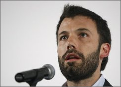 """Actor Ben Affleck performs an excerpt from """"The People Speak"""" at the Starz Green Room in Denver, Wednesday, Aug. 27, 2008. (AP Photo/Matt Sayles)"""