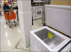 A shopper passes a freezer for sale at a Home Depot store Wednesday, Aug. 27l, 2008, in Chicago. Sales in the first six months are up more than 7 percent from last year as shoppers nationwide are re-embracing the deep freezer, stashing bulk-sized purchases as they work to combat rising food prices. (AP Photo/M. Spencer Green)