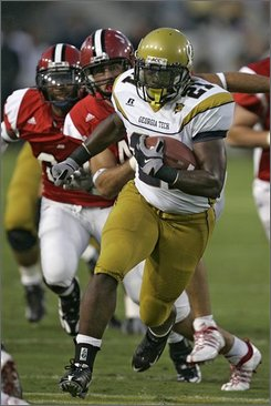 Georgia Tech running back Jonathan Dwyer breaks away from Jacksonville State's Andrew Ridgeway during the the first quarter of a football game Thursday, Aug. 28, 2008 in Atlanta. (AP Photo/John Bazemore)