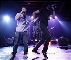 Jonny 5, left, and Brer Rabbit, of the Flobots, perform with the band at the GRAMMY's Rock The Conventions concert in Denver, Tuesday, Aug. 26, 2008. (AP Photo/Matt Sayles)
