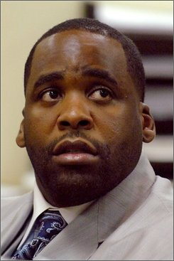 FILE **In this Aug. 7, 2008 file photo, Detroit Mayor Kwame Kilpatrick attends a hearing in 36th District Court in Detroit, Mich.  Michigan's Gov. Jennifer Granholm and Detroit's embattled mayor have had a strained relationship for years, and the tension is bound to escalate when she holds a hearing next week to decide whether to remove him from office for misconduct.   (AP Photo/Bryan Mitchell, File)
