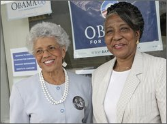 """Josie Johnson, left, and Lucy Buckner-Watson, Minnesota delegates to the Democratic National Convention, both attended Martin Luther King Jr.'s """"I have a Dream"""" speech in 1963 and will make history when they anoint the party's first black presidential nominee. They are shown outside the Minnesota Obama headquarters  Aug. 14, 2008 in St. Paul, Minn. (AP Photo/Jim Mone)"""