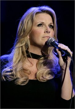 In this Feb. 21, 2008 file photo, singer Trisha Yearwood performs as part of Nissan Live Sets on Yahoo! Music in Los Angeles. (AP Photo/Matt Sayles, file)