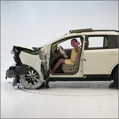 In this 2007 photo provided by the Insurance Institute for Highway Safety, a crash test is conducted on a 2007 Ford Edge. While Ford hurries to curtail billions of dollars in losses and shift from its reliance on selling bigger vehicles with bigger profit margins, one reason why Ford says it can't get its European cars to the U.S. market before 2010 is a web of different safety regulations covering everything from the positioning of crash test dummies to the color of rear turn signals.(AP Photo/Insurance Institute for Highway Safety) **NO SALES