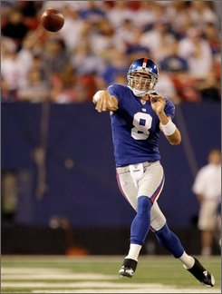 New York Giants quarterback David Carr throws a second-quarter pass during an NFL preseason football game against the New England Patriots at Giants Stadium in East Rutherford, N.J., Thursday, Aug. 28, 2008. (AP Photo/Kathy Willens)