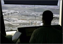 In this June 30, 2008, a controller watches over air traffic from the control tower at Newark Liberty International Airport in Newark, N.J. When a computer glitch at a Federal Aviation Administration center caused widespread airline delays this week, the agency and some of its critics called it a reminder of the importance of a pending modernization of the nation's flight system. (AP Photo/Mel Evans)