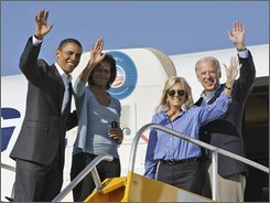 Democratic presidential candidate Sen. Barack Obama, D-Ill., with his vice presidential running mate Sen. Joe Biden, D-Del., right, with their wives Michelle Obama and Jill Biden wave before they board the plane at the airport in Denver Friday, Aug. 29, 2008.(AP Photo/Alex Brandon)