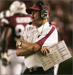  South Carolina coach Steve Spurrier watches his team play against North Carolina State's during the first quarter of a football game Thursday, Aug. 28, 2008, at Williams-Brice Stadium in Columbia, S.C. (AP Photo/Mary Ann Chastain)