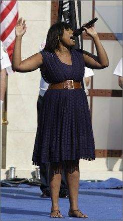 Actor and singer Jennifer Hudson sings the national anthem at the Democratic National Convention in Denver, Thursday, Aug. 28, 2008.  (AP Photo/Ron Edmonds)
