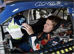 Driver Carl Edwards prepares for practice for the NASCAR Pepsi 500 auto race at Auto Club Speedway in Fontana, Calif., Friday, Aug. 29, 2008.  (AP Photo/Reed Saxon)