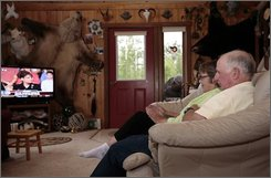 Chuck Heath, right, and his wife Sally watch, in their home in Wasilla, Alaska, as Sen. John McCain announces that their daughter, Alaska Gov. Sarah Palin is his running mate and choice for vice president Friday Aug. 29. 2008.  (AP Photo/Al Grillo)