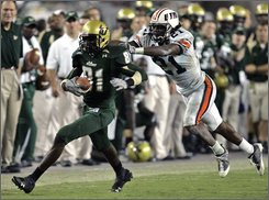 South Florida wide receiver Dontavia Bogan (81) outruns Tennessee Martin's Anthony Ivy after making a third-quarter reception during an NCAA college football game Saturday Aug. 30, 2008, in Tampa, Fla. (AP Photo/Chris O'Meara)