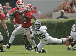 Georgia's Knowshon Moreno (24) breaks free from Georgia Southern defender Brandon Echols (25) after making a catch in the second quarter  of a football game Saturday, Aug. 30, 2008 in Athens, Ga. (AP Photo/John Bazemore)