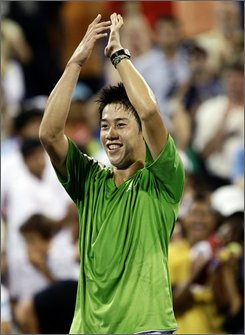 Kei Nishikori, of Japan, celebrates after winning against David Ferrer, of Spain,  during their tennis match at the U.S. Open in New York, Saturday, Aug. 30, 2008. Nishikori won 6-4, 6-4, 3-6, 2-6, 7-5. (AP Photo/Kathy Willens)