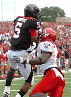 Texas Tech's Michael Crabtree, left,  makes a touchdown catch over Eastern Washington's Ryan Kelley during a football game Saturday, Aug. 30, 2008 at Jones AT&T Stadium in Lubbock. (AP Photo/Lubbock Avalanche-Journal, John A. Bowersmith)