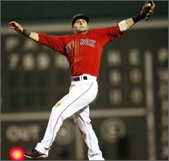 Boston Red Sox second baseman Dustin Pedroia makes a leaping catch on Chicago White Sox's Joe Crede during the seventh inning of a baseball game at Fenway Park in Boston, Saturday, Aug. 30, 2008. (AP Photo/Winslow Townson)