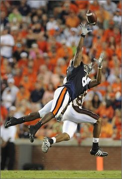 Auburn defender Jerraud Powers, near, breaks up a Louisiana-Monroe pass to receiver Anthony McCall during the first half of a college footabll game on Saturday, Aug. 30, 2008 in Auburn, Ala.(AP Photo/Todd J. Van Emst)