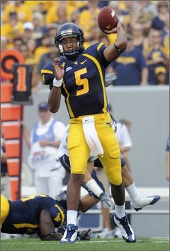 West Virginia's Pat White throws a pass against Villanova during the first quarter of a college football game Saturday, Aug. 30, 2008 in Morgantown, W.Va. (AP Photo/Jeff Gentner)