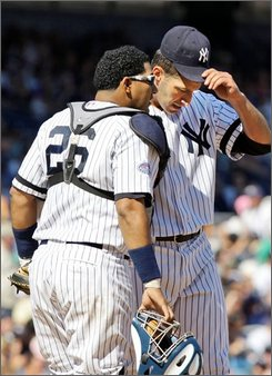 New York Yankees catcher Jose Molina, left, talks to pitcher Andy Pettitte in the sixth inning of their baseball game at Yankee Stadium in New York, Sunday, Aug. 31, 2008. Pettitte gave up six runs in the Yankees game against the Toronto Blue Jays. (AP Photo/Kathy Willens)