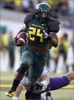 Oregon running back Jeremiah Johnson (24) breaks away from Washington defender Tripper Johnson during college football action in Eugene, Ore., Saturday, Aug. 30, 2008. (AP Photo/Don Ryan)