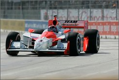 Helio Castroneves, of Brazil, takes turn one during the IndyCar Series' Detroit Belle Isle Grand Prix auto race Sunday, Aug. 31, 2008, in Detroit. (AP Photo/Carlos Osorio)
