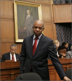 In this Oct. 16, 2007 file photo, Rep. William Jefferson, D-La., stands on Capitol Hill in Washington prior to the start of a House Judiciary Committee hearing.  Jefferson is awaiting trial in Virginia on federal bribery charges; his brother and two sisters are ensnared in a separate federal criminal case in New Orleans, but few people are counting Jefferson completely out as he faces six challengers in Saturday's Democratic primary.  (AP Photos/Susan Walsh, File)
