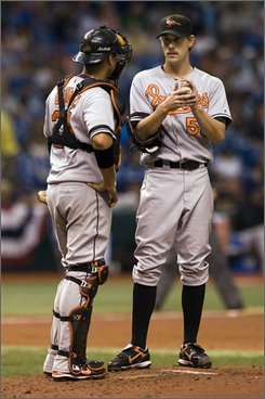 Baltimore Orioles catcher Guillermo Quiroz, left, talks with starting pitcher Brian Burres on the mound during the third inning of a baseball game against the Tampa Bay Rays Sunday, Aug. 31, 2008 in St. Petersburg, Fla. (AP Photo/Steve Nesius)