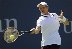 Nikolay Davydenko of Russia  returns the ball to Dmitry Tursunov of Russia during their match at the U.S. Open tennis tournament in New York, Sunday, Aug. 31, 2008.  (AP Photo/Stephen Chernin)
