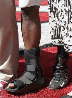 Ohio State running back Chris Wells's right foot is covered in a boot after a college football game against Youngstown State, Saturday, Aug. 30, 2008 in Columbus, Ohio. (AP Photo/Kiichiro Sato)