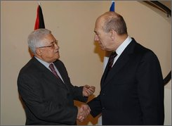 In this photo released by the Israeli Government Press Office, Israel's Prime Minister Ehud Olmert, right, and Palestinian President Mahmoud Abbas, left, meet in Jerusalem, Sunday, Aug. 31, 2008. Israeli Prime Minister Ehud Olmert hosted Palestinian President Mahmoud Abbas at his Jerusalem residence Sunday to discuss the state of peace talks as Olmert's exit draws closer. (AP Photo/ GPO, Moshe Milner, HO)