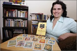 Psychotherapist Jean O'Neal sits with tarot cards and books on feng shui at her office in St. Johnsbury, Vt., Thursday, Aug. 21, 2008. For more than 40 years, foretunetelling, palm and tarot card reading weren't welcome in this town. But last month, St. Johnsbury revoked its ban, at the urging of O'Neal, who says the ordinance also prohibited feng shui, an ancient Chinese practice of harmonizing one's environment for health and financial benefits. (AP Photo/Toby Talbot)