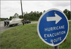 Evacuees from Dauphin Island, Ala. follow the evacuation route just south of  Mobile, Ala., Sunday, Aug. 31, 2008.  Gov. Bob Riley ordered a mandatory evacuation of parts of the Alabama coast on Sunday. (AP Photo/Darron Cummings)