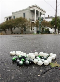 Mardi Gras beads lay in the middle of Magazine Street after blowing down from the power lines as Hurricane Gustav comes in Monday, Sept. 1, 2008, in New Orleans. (AP Photo/Brian Lawdermilk)