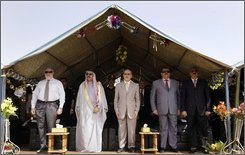 Sunni leader Sheikh Ahmed Abu Risha, 2nd left, Iraq's national security adviser Mouwaffak al-Rubaie, center, and Anbar Province Governor Maamoun Sami Rashid, 2nd right, stand during a handover ceremony at the government headquarters in Ramadi, capital of Anbar province, in Iraq Monday, Sept. 1, 2008. The U.S. military handed over control of the once brutally violent Anbar province to Iraqi forces Monday, marking a major milestone in America's plan to eventually send its troops home, but American officials warned that the struggle against insurgents was not over in the western region. (AP Photo/Wathiq Khuzaie, Pool)