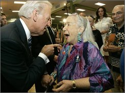 Democratic vice presidential candidate Sen. Joe Biden, D-Del., left, chats with Annalou Trebitz, 87, of Deerfield Beach, Fla., after a town hall meeting Tuesday, Sep. 2, 2008 at Century Village in Deerfield Beach. (AP Photo/Wilfredo Lee)