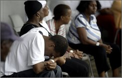 Evacuees from Hurricane Gustav sit outside a shelter in Shreveport, La., Tuesday, Sept. 2, 2008. Many of the people that fled the storm are complaining about sub-standard facilities devoid of any Red Cross or FEMA aid.  (AP Photo/LM Otero)